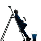 Man house painter worker worker silhouette. One caucasian man house painter worker silhouette in studio on white background Royalty Free Stock Photos