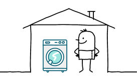 Man in house & washing machine Royalty Free Stock Image