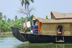 Man in houseboat. A man in a houseboat in the backwaters in Kerala, India Stock Images