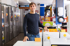Man at household appliances store Stock Photo