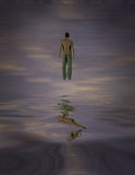 Man Hovers Above Water Stock Photography