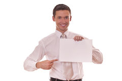 Man hows finger on blank paper Stock Images