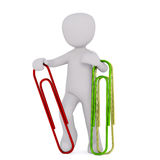Man with huge clips. Little faceless 3D man holding several colored paper clips , standing isolated on white background Stock Image