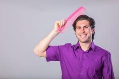 Man with huge comb Stock Photos