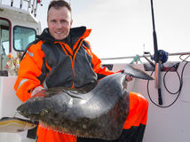 Man with huge halibut fishing trophy Stock Photos
