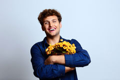 Man hugging bucket with flowers Stock Images