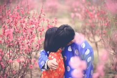 Man Hugging Girl in Orange Clothes royalty free stock photos