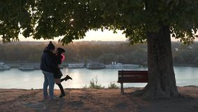 Man hugging a girl in the sunlight stock video footage