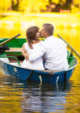 Man hugging girlfriend on boat Royalty Free Stock Photos