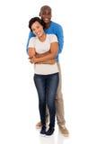 Man hugging girlfriend Stock Photo