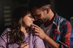 Man hugging girlfriend and touching her lips while she smiles. Beautiful sunny day royalty free stock photo