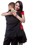 Man hugging happy woman with money Royalty Free Stock Image