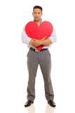Man hugging heart shape Royalty Free Stock Images