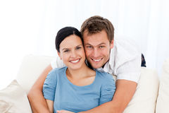 Man hugging his girlfriend while relaxing Stock Images