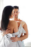 Man hugging his half naked girlfriend Stock Image