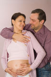 Man hugging his pregnant wife Stock Photography