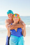 Man hugging his wife at the beach Stock Photography