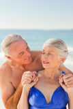Man hugging his wife at the beach Stock Photo