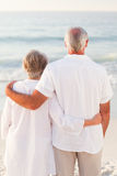 Man hugging his wife on the beach Royalty Free Stock Photo