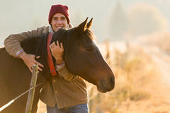 Man hugging horse Royalty Free Stock Photos