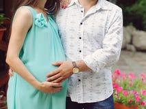 Man Hugging Pregnant Beloved Stock Photo