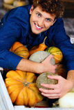 man hugging pumpkins Royalty Free Stock Photo
