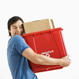 Man hugging recycling bin. Royalty Free Stock Photography