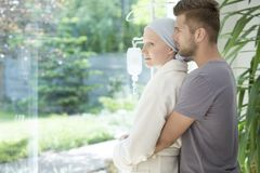 Man hugging sick girlfriend with breast cancer during treatment royalty free stock photo
