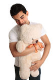 Man hugging a teddy Royalty Free Stock Photography
