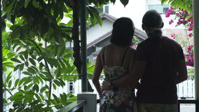 A man hugging a woman on a balcony stock video