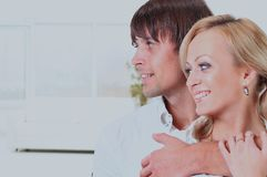 Man hugging a woman, they look toward. Stock Photography