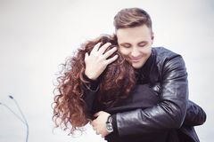 Man hugging a woman he in love with and smile Royalty Free Stock Image