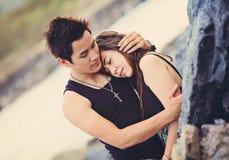 Man Hugging a Woman Wearing Black Tank Top Royalty Free Stock Images