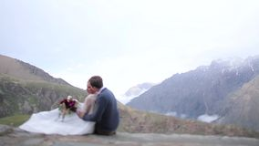 Man hugging women on the background of mountains stock video footage