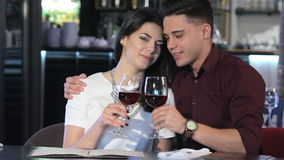 Man hugs his girlfriend at the restaurant stock video footage