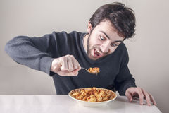 Man hungry for food. Man hungry for italian food Stock Images