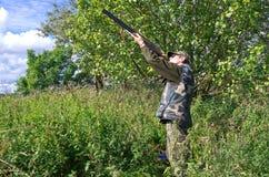 Man hunter aiming pigeons Royalty Free Stock Photos