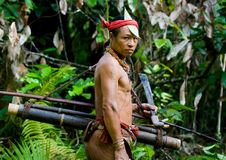 Free Man Hunter Mentawai Tribe With A Bow And Arrow In The Jungle. Stock Image - 81019931