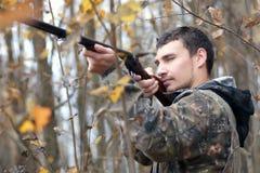 Man hunter outdoor in autumn hunting. Man hunter outdoor in autumn forest hunting alone Royalty Free Stock Image