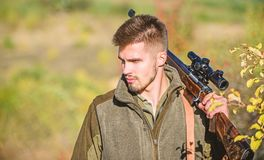 Man hunter with rifle gun. Boot camp. Hunting skills and weapon equipment. How turn hunting into hobby. Military uniform. Fashion. Bearded man hunter. Army royalty free stock photography