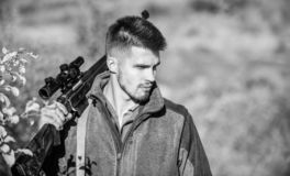 Man hunter with rifle gun. Boot camp. Hunting skills and weapon equipment. How turn hunting into hobby. Military uniform. Fashion. Bearded man hunter. Army stock image