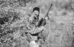 Man hunter with rifle gun. Boot camp. Military uniform fashion. Bearded man hunter. Army forces. Camouflage. Hunting. Skills and weapon equipment. How turn stock image