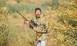 Man hunter with rifle gun. Boot camp. Military uniform fashion. Bearded man hunter. Army forces. Camouflage. Hunting. Skills and weapon equipment. How turn stock photography