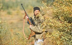 Man hunter with rifle gun. Boot camp. Military uniform fashion. Bearded man hunter. Army forces. Camouflage. Hunting. Skills and weapon equipment. How turn stock photo