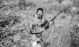 Man hunter with rifle gun. Boot camp. Military uniform fashion. Bearded man hunter. Army forces. Camouflage. Hunting. Skills and weapon equipment. How turn royalty free stock photos
