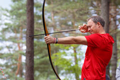 Man hunter shot with bow in open air Royalty Free Stock Image