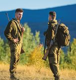 Man hunters with rifle gun. Boot camp. Friendship of men hunters. Army forces. Camouflage. Military uniform fashion. Hunting skills and weapon equipment. How royalty free stock images