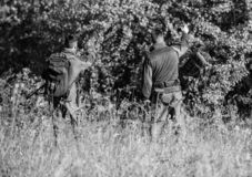 Man hunters with rifle gun. Boot camp. Hunting skills and weapon equipment. How turn hunting into hobby. Military royalty free stock image