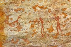 Man hunting bushman's ancient wall artwork Stock Photo