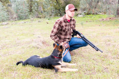 Man Hunting With Dog Stock Photography
